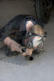 Mechanic welding the exhaust Royalty Free Stock Photography