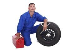 Mechanic with wheel Stock Photos