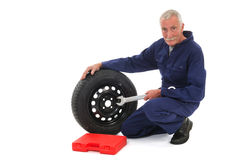 Mechanic with wheel and wrench Royalty Free Stock Photos