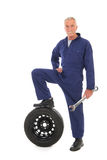Mechanic with wheel and wrench Royalty Free Stock Photo