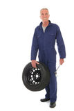 Mechanic with wheel and wrench Royalty Free Stock Image