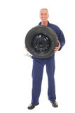 Mechanic with wheel and wrench Royalty Free Stock Photography