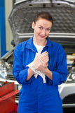 Mechanic wiping hands with rag Royalty Free Stock Photos