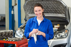 Mechanic wiping hands with rag. At the repair garage Stock Image