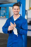 Mechanic wiping hands with rag Stock Photo