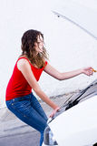 Mechanic woman. Woman checking engine car problems Stock Photo