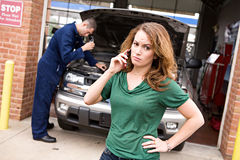 Mechanic: Woman Angry At Repair Cost Stock Photo