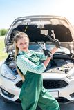 Mechanic woman posing with wrenches stock photography