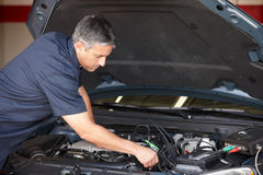 Mechanic at work. Fixing car royalty free stock photography