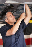 Mechanic at work. Under car royalty free stock images