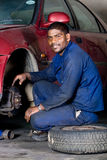 Mechanic at work. An indian mechanic working on a vehicle tyre stock photos