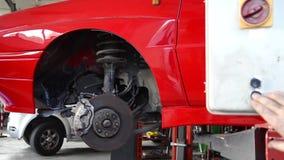 Mechanic at work. Automobile repair shop, mechanic at work stock footage