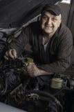 Mechanic at work. DIY mechanic changing engine in car royalty free stock image