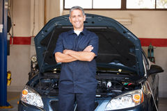Mechanic at work in front of car royalty free stock photography