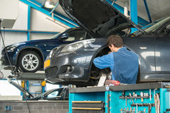 Mechanic at work in a garage Royalty Free Stock Photo