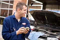 Mechanic: Worker Makes Money from Overcharging Royalty Free Stock Photos