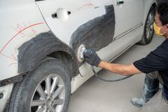 Car body work after the accident by preparing automobile for painting during repair stock images