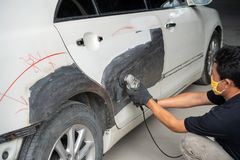Car body work after the accident by preparing automobile for painting during repair royalty free stock photography