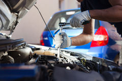 Mechanic working in auto repair garage. Car maintenance Stock Photography