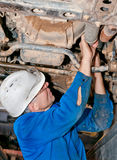 Mechanic working on a broken down vehicle Stock Photography