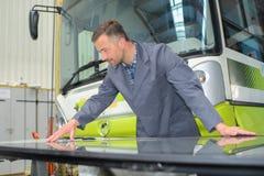 Mechanic working on bus stock image