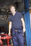 Mechanic working on car Stock Photo