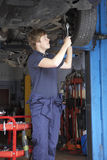Mechanic working on car Stock Image