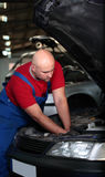 A mechanic working on a car Royalty Free Stock Image