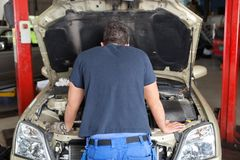Mechanic working on a car Stock Photo