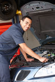 Mechanic working on car Stock Photo
