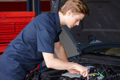 Mechanic working on car Royalty Free Stock Images