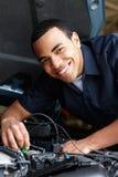 Mechanic working on car Stock Image