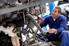 Mechanic working on a car Royalty Free Stock Photography