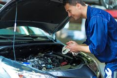 Car mechanic working on a car Stock Photos