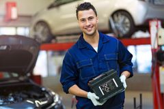 Car mechanic working on a car Stock Photo