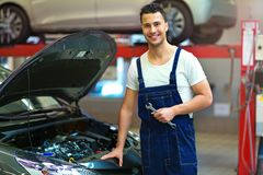 Car mechanic in auto repair shop royalty free stock images