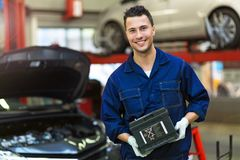 Car mechanic working on a car Stock Image