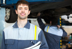 Mechanic working in car repair service. Car mechanic working in car repair service Stock Photo