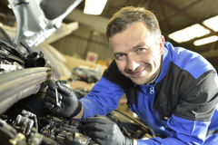 Mechanic working on car reparations stock photos