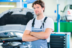 Mechanic working - car workshop Stock Photo