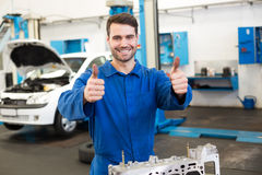 Mechanic working on an engine. At the repair garage Royalty Free Stock Photo