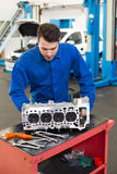 Mechanic working on an engine Royalty Free Stock Image