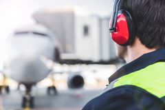 Mechanic working in headset at airport Stock Photo