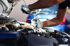 Free Mechanic Working In Auto Repair Garage. Car Maintenance Stock Photography - 76981082
