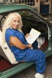 Mechanic working inside car Stock Photography