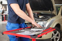 Mechanic working on a laptop Royalty Free Stock Photography