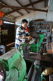 Mechanic working  mechanical workshop Stock Images