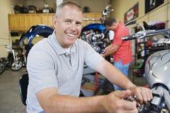 Mechanic Working On Motorcycle Stock Image