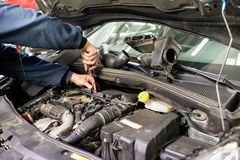 Free Mechanic Working On A Car Engine Doing Repairs Stock Image - 145169041