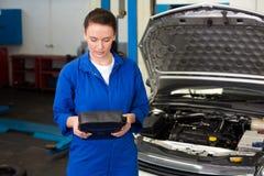Mechanic working with open hood Royalty Free Stock Photo